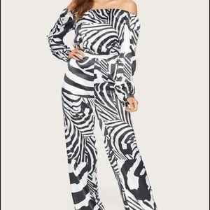 Bebe printed off shoulder abstract zebra jumpsuit